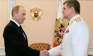 Russian President Vladimir Putin shakes hands with general prosecutor Yuri Chaika.