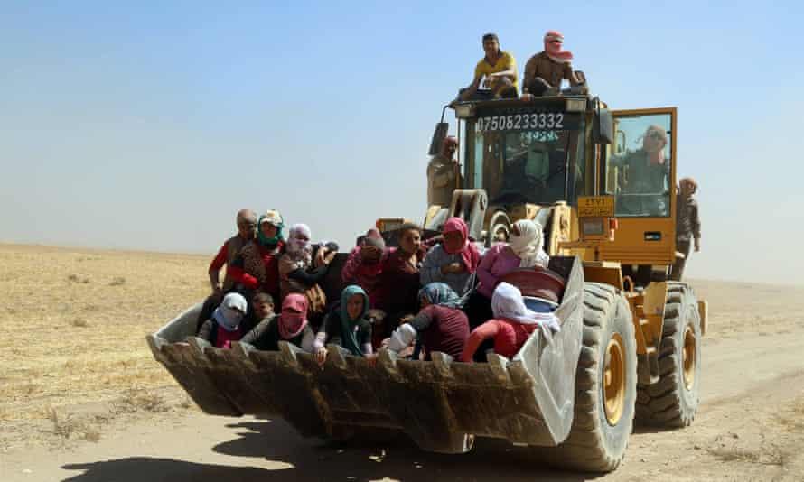 Kurdish peshmerga forces rescue Yazidis after they were trapped on Mount Sinjar.