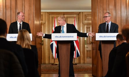 Boris Johnson flanked by England's chief medical officer, Chris Whitty (left), and government chief scientific adviser Patrick Vallance at a daily coronavirus briefing in March.