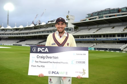 Craig Overton poses with the PCA Most Valuable Rankings cheque after finishing as the best performing player in the Bob Willis Trophy.