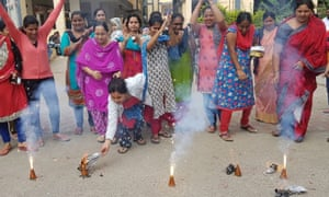Indian women burn crackers