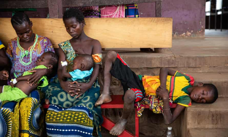 A child with measles awaits treatment with his family at a healthcare facility in Central African Republic.