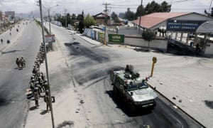 Soldiers guard the state-owned Senkata filling gas plant in El Alto on Tuesday.