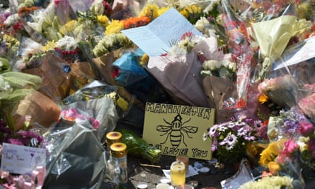 Flowers and messages of support are pictured in St Ann's Square in Manchester