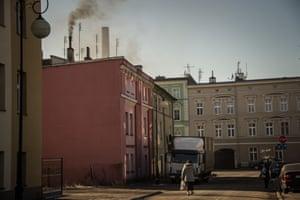 A domestic chimney spews dark smoke in Głuchołazy