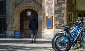 A student outside Trinity College, Cambridge