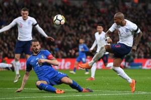 Ashley Young of England shoots and Leonardo Bonucci of Italy blocks