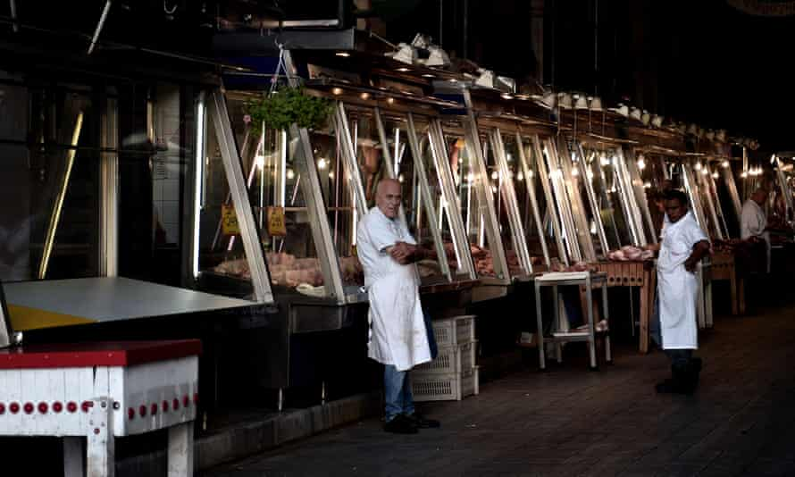 A man stands outside his shop in Athens' central meat market.