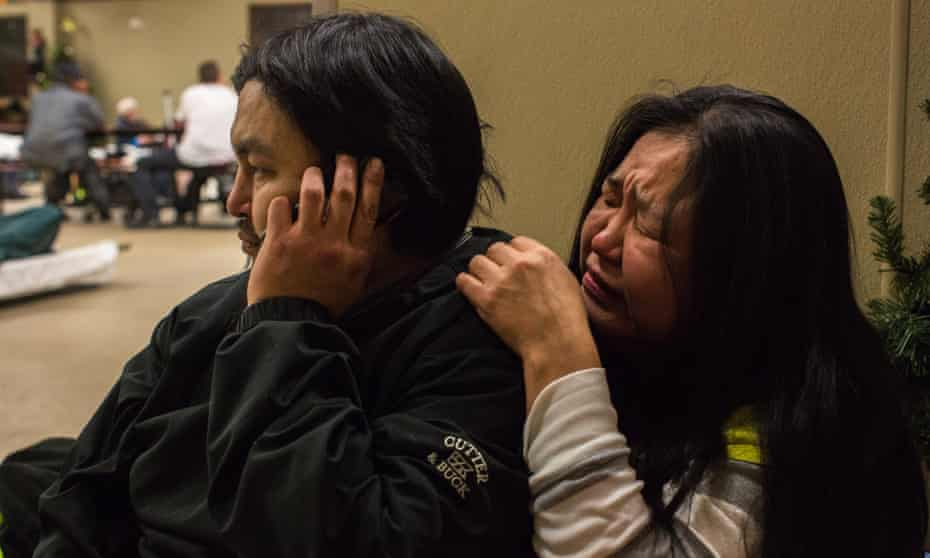 Marie Nickolai sobs while her partner, Steven Moses, tells family members about Isaac's death.