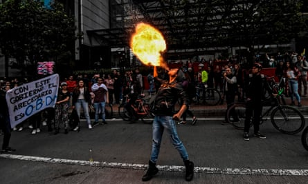 A student spits fire during a protest for Dilan Cruz in Bogotá, Colombia, on 26 November.