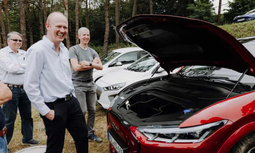 Enthusiasts check out an electric car
