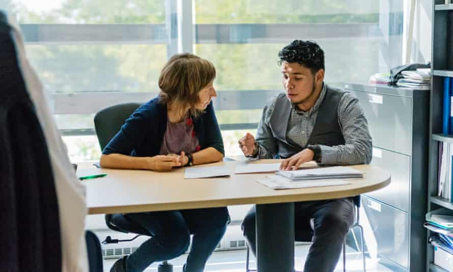 ◀ Students should be aware of what help is at hand for mental health problems. Posed by models. photograph: gettyCounselling appointment for young latino man student in counsellor College office. Horizontal indoors backlit full length shot with copy space.