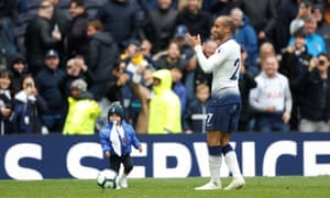 Tottenham's Lucas Moura celebrates after the match with his son Miguel.