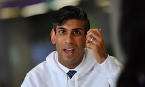 Head and shoulders shot of Rishi Sunak in a shirt and tie with a white hoodie