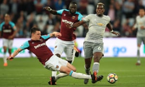 Declan Rice of West Ham in action with Paul Pogba.