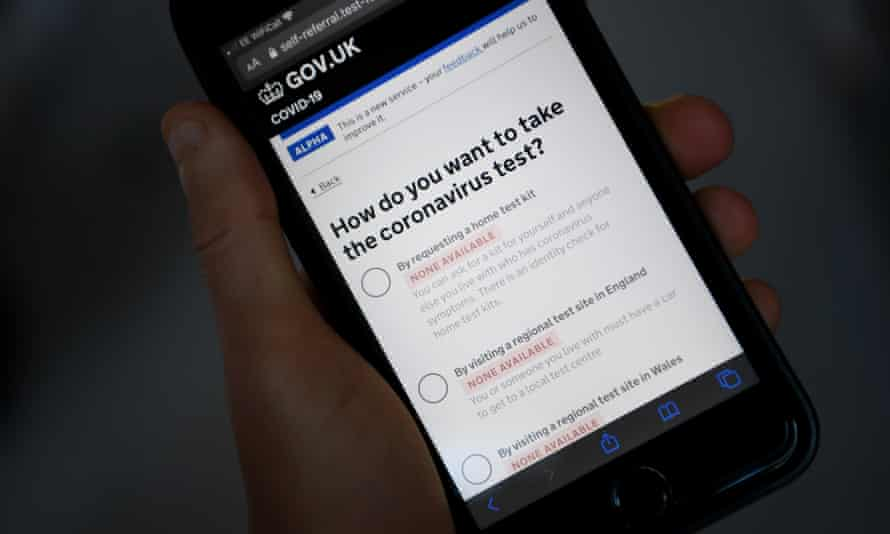 Mobile phone showing of the UK government's coronavirus test application website