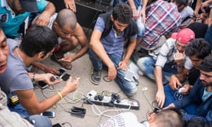 Refugees charge their phones