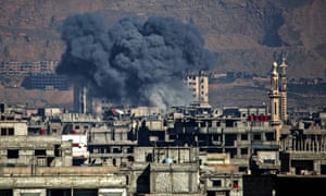 Smoke billows following an airstrike in the Syrian rebel-held town of Arbin