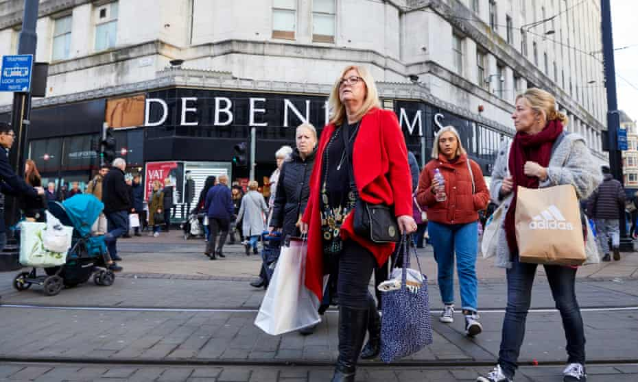 Shoppers on Black Friday outside Debenhams department store in Manchester