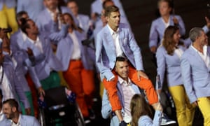 The Australians wearing lavender blue jackets and orange or yellow trousers brighten up the parade.