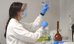 A chemist works at AstraZeneca's headquarters in Sydney, Australia.