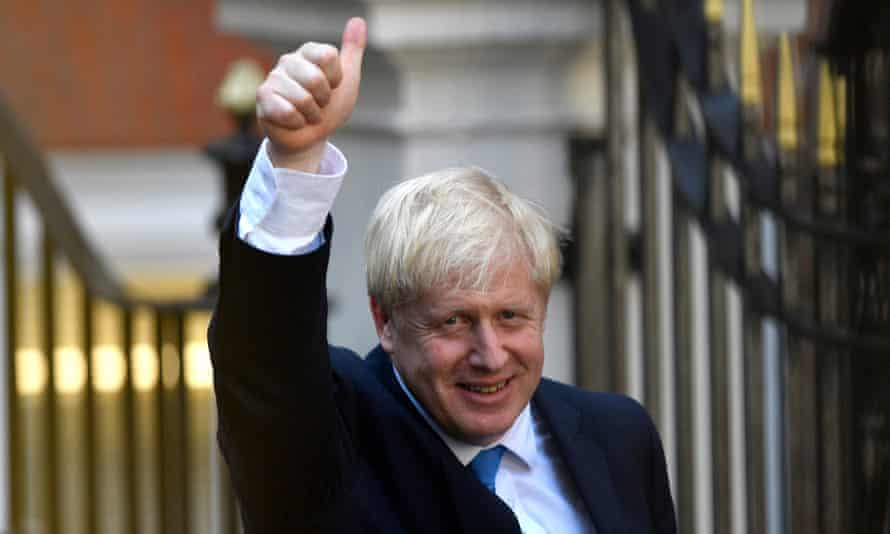 Boris Johnson leaves the Conservative party headquarters after being announced as their new leader