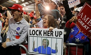 a pro-Trump rally in Virginia last November. Woman holds a 'lock her up' placard