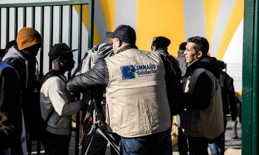 Social workers check migrants from Calais at a new centre at Porte de la Chapelle in Paris, France