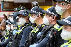 Police stand guard at the Black Lives Matter rally organised by the Warriors of Aboriginal Resistance in Melbourne, Australia