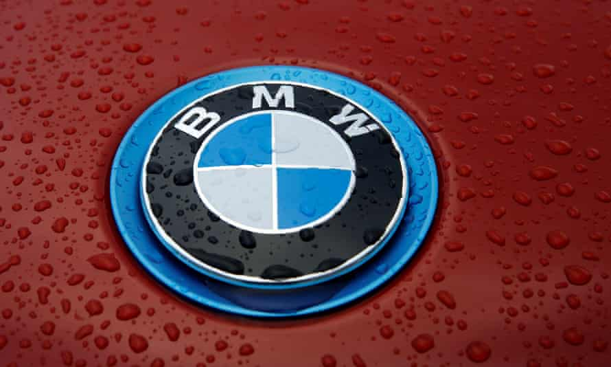 Raindrops cover the bonnet of a BMW car