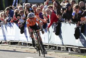 Annemiek van Vleuten is cheered on by the fans.