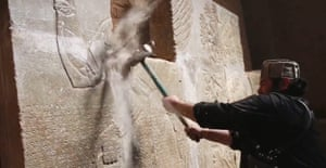 Screengrab from a video released by Isis allegedly showing a member destroying parts of a frieze at the ancient Iraqi town of Nimrud.