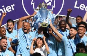 Vincent Kompany lifts the Premier League Trophy with Sergio Aguero.