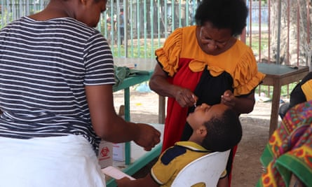 Sister Kenegalato Waligia gives polio vaccine drops to Immanual Kyakagn, aged 7, at Gerehu general hospital in Port Moresby, Papua New Guinea.