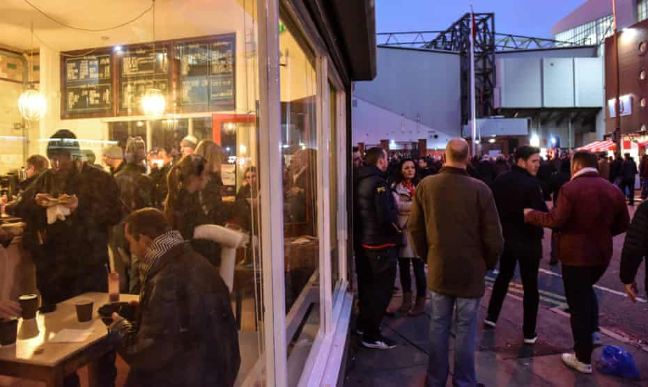 Football fans stop off at Homebaked bakery near Anfield football stadium on match day