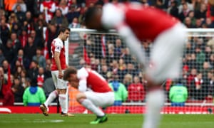 Arsenal's players slump after being held to a 1-1 draw with Brighton. Following Chelsea's victory it leaves Arsenal highly unlikely to qualify for the Champions League via a top-four finish, given that they are three points behind Tottenham with an inferior goal difference. Their best hope now is to win the Europa League.