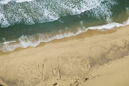 A closed Bronte beach in Sydney with the words #StayHome written into the sand by local lifeguards.