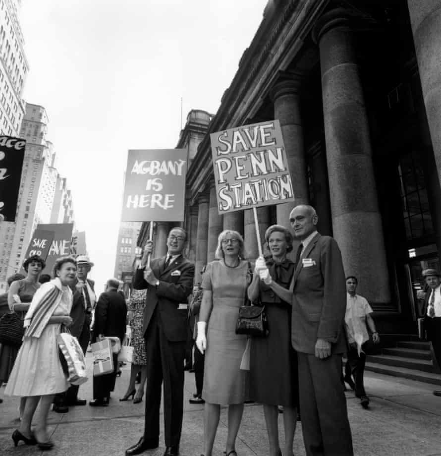 Jane Jacobs and architect Philip Johnson, right, stand with picketing crowds outside Penn Station to protest the building's demolition.