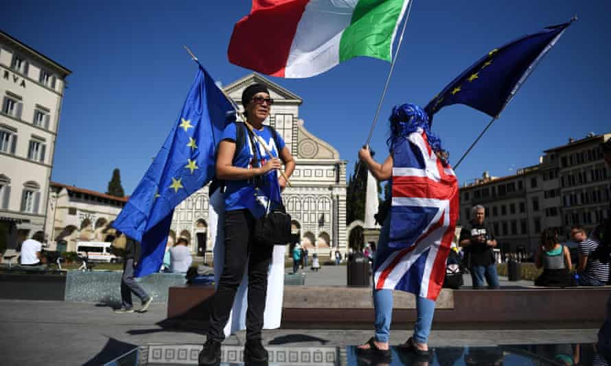 Protesters gather before Theresa May's Brexit speech in Florence, Italy.