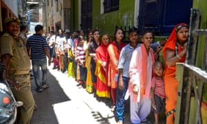 Voters queue at a polling station in Modi's constituency of Varanasi, Uttar Pradesh.