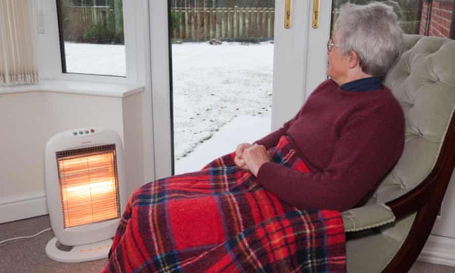 Elderly old woman at home with heater