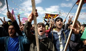 Kurdish youths and men chant slogans during the Newroz spring festival in Diyarbakir in south-east Turkey.