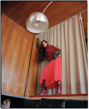 Jumper, £825, skirt, £1,250, gloves, £545, and boots, £1,195, all by Victoria Beckham. Earring, £160, by Alighieri.