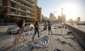 People run in the aftermath of a massive explosion in Beirut, Lebanon, Tuesday, 4 August 2020.