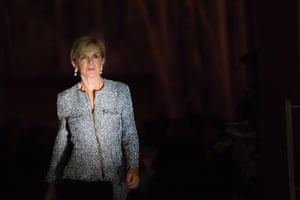 A sliver of early morning light spotlights the foreign affairs minister, Julie Bishop, as she leaves the annual CEDA conference breakfast in the great hall
