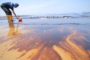 Authorities clean Banua Patra beach in Balikpapan bay