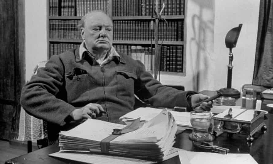 Winston Churchill at his desk.