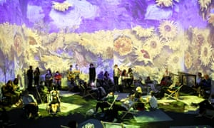 London, England: People watch a 360-degree animated montage of work by the Dutch artist Vincent Van Gogh at Van Gogh: The Immersive Experience