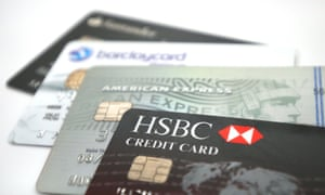 A selection of four credit cards; HSBC, American Express, Barclayscard and Santander