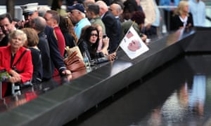 People wait at the Ground Zero south reflecting pool for Pope Francis.